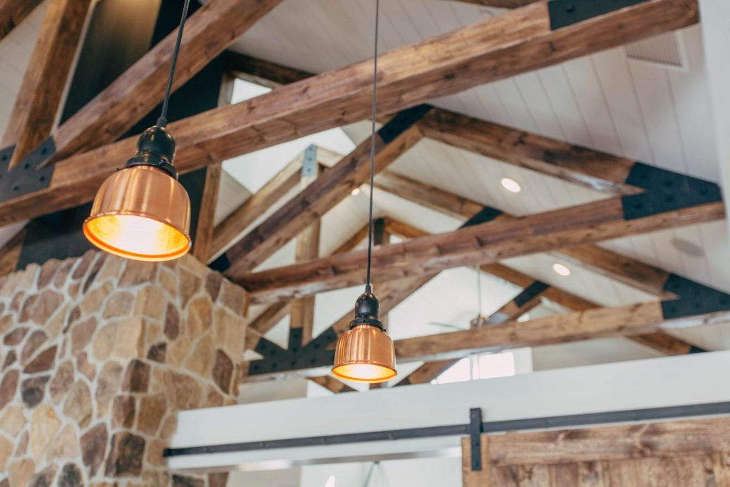 Lights hanging from rustic wooden beams