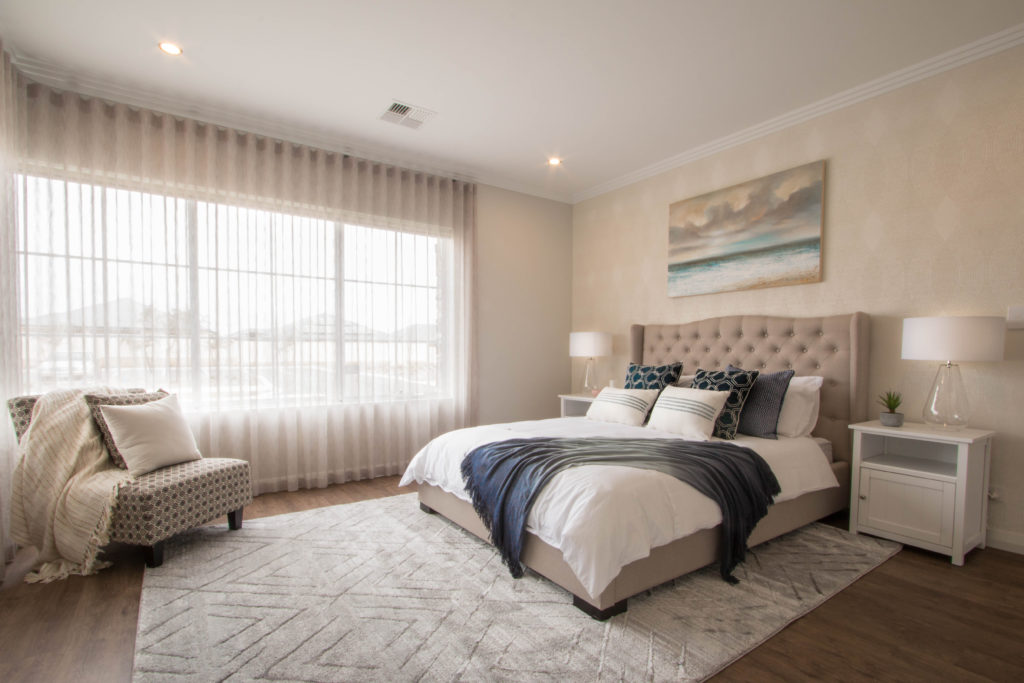 Hamptons style bedroom with luxurious bed and soft furnishings