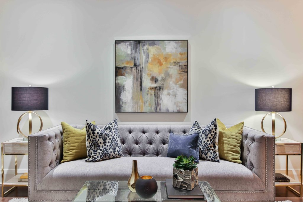 Hamptons style loungesuite with colourful cushions, lamps and abstract artwork